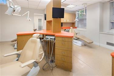 Dental Operatory with glass windows and busy city street outside