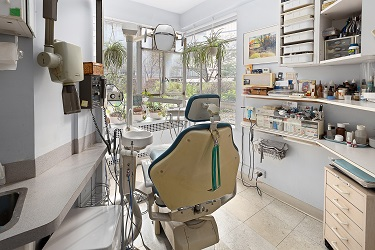 dental op with large windows looking onto busy street