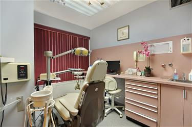 Dental operatory with large windows facing busy city street